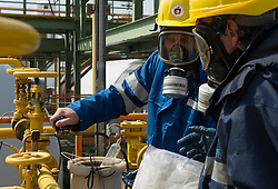 Thomas Pauwels, left, and Andre Rijmenans, both chemists, take samples of liquid chlorine at the Solvay SA chemical plant in Antwerp, Belgium, on Thursday, April 22, 2010. Since the boiling point of liquid chlorine is minus 34.1 degrees Celsius, (-34.1 °C) the glass tubes containing the samples are submerged in dry ice. Solvay SA is the world's largest supplier of Soda Ash or Sodium Carbonate and is also a major producer of caustic soda, hydrogen peroxide, chlorine and fluorinated products. (Photo © Jock Fistick)