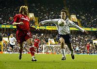 Photograph: Scott Heavey.<br />Tottenham Hotspur v Middlesbrough. FA Barclaycard Premiership. 26/10/2003.<br />Mauricio Taricco watches the ball from Gaizka Mendieta