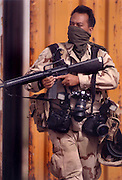 Parvan, Afghanistan (August 30, 2002) --  U.S. Navy Chief Photographer's Mate Johnny Bivera of Pensacola, Fla., is deployed with U.S. Army Civil Affairs during a routine patrol in the northeastern region of Afghanistan. (RELEASED).