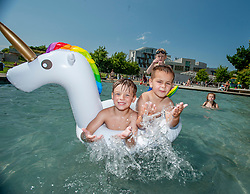 Alfie Hunter (5) and Solo Blyth (5) both from Edinburgh and Steven Hunter (9) have fun in the ponds outside the Scottish Parliament, on what is predicted to be the hottest day of the year.<br /> <br /> © Dave Johnston / EEm