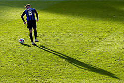 Aaron Morley of Rochdale runs with the ball as long shadow is cast behind him - Mandatory by-line: Robbie Stephenson/JMP - 31/10/2020 - FOOTBALL - Crown Oil Arena - Rochdale, England - Rochdale v Bristol Rovers - Sky Bet League One