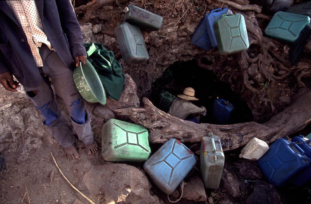 Men at waterhole in Ethiopia<br /> <br /> Pic Steve Morgan