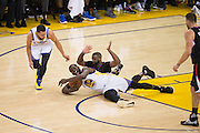 Golden State Warriors forward Draymond Green (23) and LA Clippers guard Raymond Felton (2) battle for a loose ball at Oracle Arena in Oakland, Calif., on February 23, 2017. (Stan Olszewski/Special to S.F. Examiner)