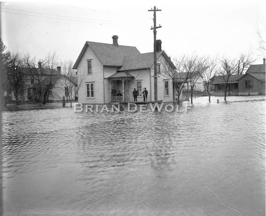Corner of Delia and State Streets (identified from street sign on the utility pole), Batavia, IL. The house is still on the N.E. corner. Possibly pictures of the flood of February 1893.