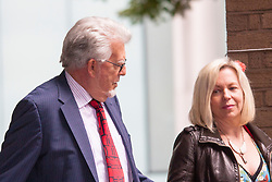 London, June 27th 2014. With the jury still to reach a verdict on the 12 charges of indecent assault against girls aged between 7 and 19, at the end of their 7th day in retirement, Rolf Harris, who denies the charges, leaves court with his daughter Bindi.