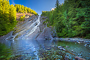Otter Falls is a waterfall in King County, Washington; on the southern wall of Mount Anderson. It drops about 1,600 feet in all, but due to the relatively moderate pitch of the mountainside, only about 1/3 of the total height can be seen from the ground.