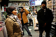 Cataclysm, 27, (left) is chatting with other artists in a Hip Hop music store in central London on Wednesday, Feb. 7, 2007, while Iron Braydz, 26, (right) is watching videos on television. Islamic Hip Hop artists like the duo 'Blind Alphabetz', from London, feel more than ever the need to say what they think aloud. In the music industry the backlash of a disputable Western foreign policy towards Islamic countries and its people is strong. The number of artists in the European Union and the US taking this into consideration and addressing the current social and political problems within their lyrics is growing rapidly and fostering awareness for Muslim and others alike.