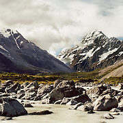 A panoramic view of Mount Cook, the highest mountain in New Zealand, reaching 3,754 metres in the Southern Alps of New Zealand.  A popular tourist destination, it is also a favourite challenge for mountain climbers. Aoraki / Mount Cook consists of three summits, the Low Peak, Middle Peak and High Peak, with the Tasman Glacier to the east and the Hooker Glacier to the west. Mount Cook, South Island, New Zealand. 23rd July 2011. Photo Tim Clayton