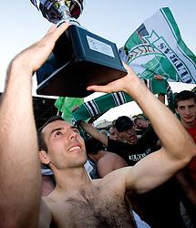 Adnan Alagic  at award ceremony celebrates with the Cup after final match of 2nd SNL league between NK Olimpija in NK Aluminij, on May 23, 2009, ZAK, Ljubljana, Slovenia. Aluminij won 2:1. NK Olimpija is a Champion of 2nd SNL and thus qualified to 1st Slovenian football league for season 2009/2010. (Photo by Vid Ponikvar / Sportida)