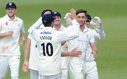 Matt Taylor of Gloucestershire celebrates with his team mates after he bowls out Alex Davis for LBW - Photo mandatory by-line: Dougie Allward/JMP - Mobile: 07966 386802 - 07/06/2015 - SPORT - Football - Bristol - County Ground - Gloucestershire Cricket v Lancashire Cricket - LV= County Championship