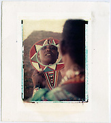 Maasai woman shows off mirror she has just made, Kenya<br /> Image size 4x5, Matted 12x10 Edition of 25 <br /> Archival Pigment Print