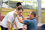 Special Olympian receiving medal at award ceremony. Special Olympics U of M Bierman Athletic Complex. Minneapolis Minnesota USA
