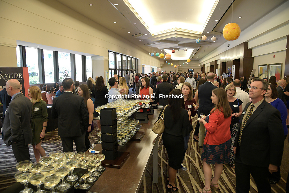 Attendees network during The Orlando Sentinel Top 100 Companies event Friday, Aug. 18, 2017. (Photo by Phelan M. Ebenhack)