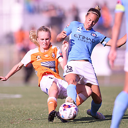 BRISBANE, AUSTRALIA - FEBRUARY 11: Kaitlyn Torpey of the Roar and Aivi Luik of Melbourne compete for the ball during the Westfield W-League Semi Final match between the Brisbane Roar and Melbourne City at Perry Park on February 11, 2018 in Brisbane, Australia. (Photo by Patrick Kearney / Brisbane Roar)