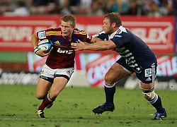 Robbie Robinson is tackled by JC Kritzinger during the Super Rugby (Super 15) fixture between the DHL Stormers and the Highlanders held at DHL Newlands Stadium in Cape Town, South Africa on 11 March 2011. Photo by Jacques Rossouw/SPORTZPICS
