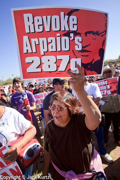 Feb. 28, 2009 -- PHOENIX, AZ: A woman holds up sign calling for the Department of Homeland Security to revoke the Maricopa County Sheriff's authority under the 287g program to investigate immigration crimes. Thousands of people in Phoenix, AZ, protested against Maricopa County Sheriff Joe Arpaio's immigration policies. Arpaio has polarized the community by conducting raids against illegal immigrants in businesses and neighborhoods in the Phoenix area that are frequented by Hispanics. Members of Congress have written to Attorney General Eric Holder and asked him to investigate Arpaio for human rights violations. Arpaio claims he has authority under the Department of Homeland Security's 287g program to investigate and arrest illegal immigrants.     Photo By Jack Kurtz