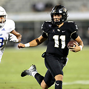 ORLANDO, FL - OCTOBER 03:  Dillon Gabriel #11 of the Central Florida Knights outruns Zaven Collins #23 of the Tulsa Golden Hurricane at Bright House Networks Stadium on October 3, 2020 in Orlando, Florida. (Photo by Alex Menendez/Getty Images) *** Local Caption *** Dillon Gabriel; Zaven Collins