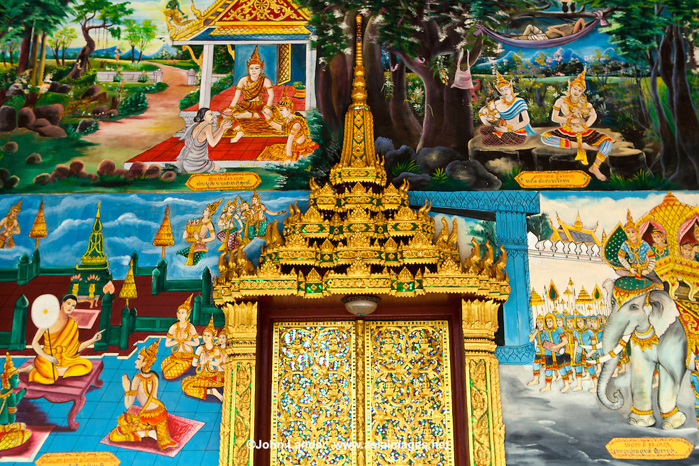 Wat Impeng in Vientiane has some fine reconstructed buildings such as this with artistic wooden carvings on the windows and doors, along with the paintings, murals and stucco work on the walls, featuring various legends from the life of Buddha.