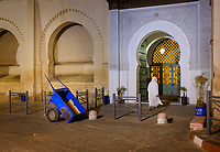 MARRAKESH, MOROCCO - CIRCA APRIL 2017: Man entering at the Grand Mosque Bab Doukkala in the Boulevard Fatima Zahra in Marrakesh. This is a local area close to the Medina.