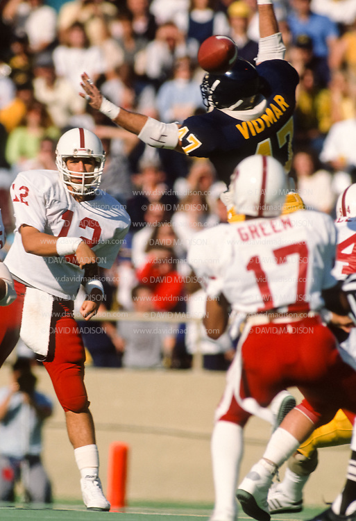 COLLEGE FOOTBALL: Stanford quarterback Jason Palumbis #12 throws a pass to Henry Green #17,  Bruce Vidmar #47 of Cal defends during the 82nd annual Stanford - Cal Big Game played on November 19, 1988  at Memorial Stadium in Berkeley, California.  Photography by David Madison   www.davidmadison.com.