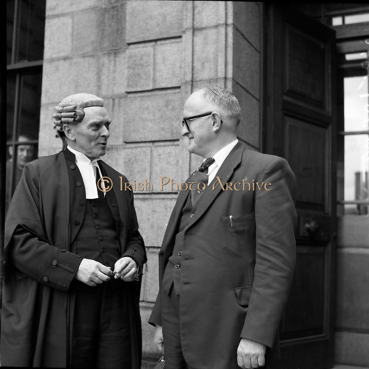 """Mr Louis O'Connell at High Court with his Barrister Mr Sean MacBride.  Court case in question was Lenihan vs O'Connell  (Special for Kerryman).12/05/1958..From Con Houlihan 'The back pages of village life'..http://www.independent.ie/opinion/columnists/con-houlihan/poetic-licence-1421362.html..'The Taxpayers' News', a magazine based in Kerry, was owned by Charlie Lenihan. He was a wealthy man that went into politics. Charlie got elected to the county council with a big majority and failed by a few hundred votes to get elected to the Dail. He would have won that election handsomely if he didn't despise number-two votes and told people who offered what to do with them. He had a drink problem and eventually it brought him to a rather early grave. ..One day on his way to Dublin to get the publication printed Mr Lenihan made changes to the text.  He referred to Louis O'Connell, a solicitor and a county councillor, as """"crooked in his business and in his politics"""". A libel action followed in which Lenihan hadn't a hope. ..Sean McBride was representing Louis O'Connell and, of course, he won easily. Sean had a slight speech defect - he couldn't pronounce a certain consonant in the alphabet. He gave a hitch unto his gown and with a piercing look said: """"Come tell me, Mr Lenihan, did you call this man a cook?"""" There was loud laughter until eventually we paid for it. The damages were heavy and eventually led to the demise of a brave little magazine. ...Seán MacBride (26/01/1904 – 15/01/1988) was an Irish government minister and prominent international politician as well as a Chief of Staff of the IRA..Rising from a domestic Irish political career, he founded or participated in many international as well as non-governmental organizations of the early 20th century, including the United Nations, the Council of Europe, and Amnesty International. He received the Nobel Peace Prize in 1974, the Lenin Peace Prize for 1975–76, and the UNESCO Silver Medal for Service in 198"""