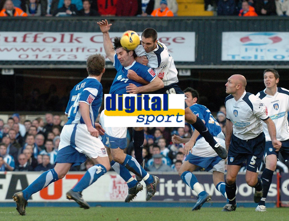Photo: Ashley Pickering.<br />Ipswich Town v Colchester United. Coca Cola Championship. 20/01/2007.<br />Ipswich's Alan Lee (blue) is fouled in the box by Colchester's Garry Richards and a penalty is awarded (1-1)