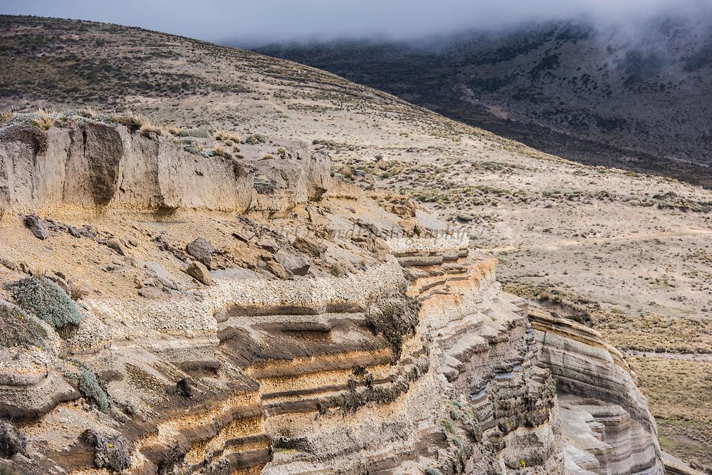 Strata of ash & sedimentary rocks<br /> Chimborazo Volcano (Highest mountain in Ecuador 6384.4 meters or 20702 feet)<br /> Andes<br /> ECUADOR, South America<br /> Inactive Volcano