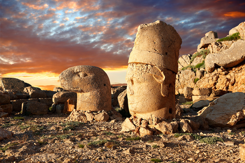 Pictures of the statues of around the tomb of Commagene King Antochus 1 on the top of Mount Nemrut, Turkey. Stock photos & Photo art prints. In 62 BC, King Antiochus I Theos of Commagene built on the mountain top a tomb-sanctuary flanked by huge statues (8–9 m/26–30 ft high) of himself, two lions, two eagles and various Greek, Armenian, and Iranian gods. The photos show the broken statues on the  2,134m (7,001ft)  mountain. 6 .<br /> <br /> If you prefer to buy from our ALAMY PHOTO LIBRARY  Collection visit : https://www.alamy.com/portfolio/paul-williams-funkystock/nemrutdagiancientstatues-turkey.html<br /> <br /> Visit our CLASSICAL WORLD HISTORIC SITES PHOTO COLLECTIONS for more photos to download or buy as wall art prints https://funkystock.photoshelter.com/gallery-collection/Classical-Era-Historic-Sites-Archaeological-Sites-Pictures-Images/C0000g4bSGiDL9rw