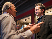 12 SEPTEMBER 2019 - CLIVE, IOWA: Governor STEVE BULLOCK (D-MT), right, talks to TIM URBAN after a campaign event in a microbrewery in Clive, IA, a suburb of Des Moines. Gov. Bullock is vying to be the Democratic party's nominee in 2020. He is campaigning in Iowa this week because he didn't qualify for the September 12 debate. Iowa traditionally hosts the the first election event of the presidential election cycle. The Iowa Caucuses will be on Feb. 3, 2020.              PHOTO BY JACK KURTZ