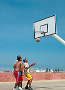 Young men play basketball at a court on the beach in the new town at Essaouira, Morocco