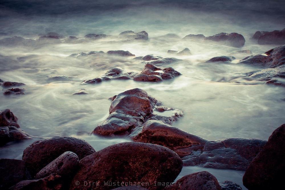 Long exposure of waves spilling over some lava rocks <br /> <br /> Prints & more. http://society6.com/DirkWuestenhagenImagery/Rocks-Stones-Water_Print