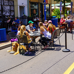 Phoenixville, PA, USA - June 14, 2020: Social distancing and dining on the main thoroughfare is on display as a street closure is effective for pedestrians.