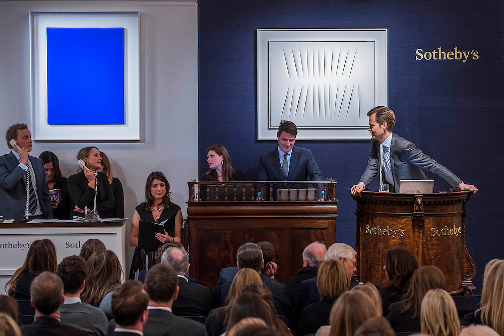 The winning bid comes over the phone via the woman to the left. Sotheby's sale of post-war and contemporary art - highlights include: a group of works from an Important Swedish Private Collection, including Lucio Fontana's rarely seen masterwork, Concetto Spaziale, Attese (1965) Estimate £5,000,000 — 7,000,000 (pictured White, and Robert Rauschenberg's Untitled (Small oil on canvas #4) (1963) Estimate £800,000 — 1,200,000; s a self- portrait diptych by Francis Bacon from 1977 Estimate £13,000,000 — 18,000,000; a monumental and mesmeric Abstraktes Bild by Gerhard Richter Estimate £14,000,000 — 20,000,000; and works by Cy Twombly, Nicolas de Staël, Yves Klein, Jean-Michel Basquiat and Andy Warhol.