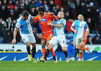 Blackpool's Nathan Delfouneso vies for possession with Blackburn Rovers' Tommy Spurr, left, and Blackburn Rovers' Jay Spearing<br /> <br /> Photographer Chris Vaughan/CameraSport<br /> <br /> Football - The Football League Sky Bet Championship - Blackburn Rovers v Blackpool - Saturday 21st February 2015 - Ewood Park - Blackburn<br /> <br /> © CameraSport - 43 Linden Ave. Countesthorpe. Leicester. England. LE8 5PG - Tel: +44 (0) 116 277 4147 - admin@camerasport.com - www.camerasport.com
