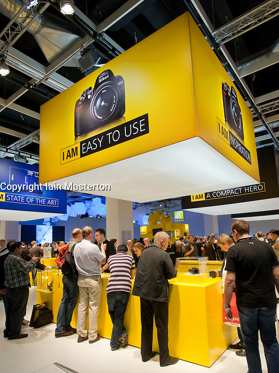 Many people at Nikon stand at Photokina digital imaging trade show in Cologne Germany