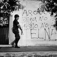 A police foot patrol on the streets of  one of the most dangerous places in Colombia. The police station in Saravena was attacked with homemade mortars 85 times in one year. Assassinations, sniper attacks and bombs are almost daily occurrences.<br />