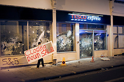 © licensed to London News Pictures. 22/04/2011. Bristol, UK  . Hundreds of protesters stormed a controversial Tesco store only days after it opened, causing tens of thousands of pounds worth of damage and injuring eight police officers. It came after police had raided a nearby squat at the centre of a campaign against the supermarket giant. Four people where arrested on suspicion of  plotting a firebomb attack on the new shop. Photo credit should read Jonathan Taphouse/LNP