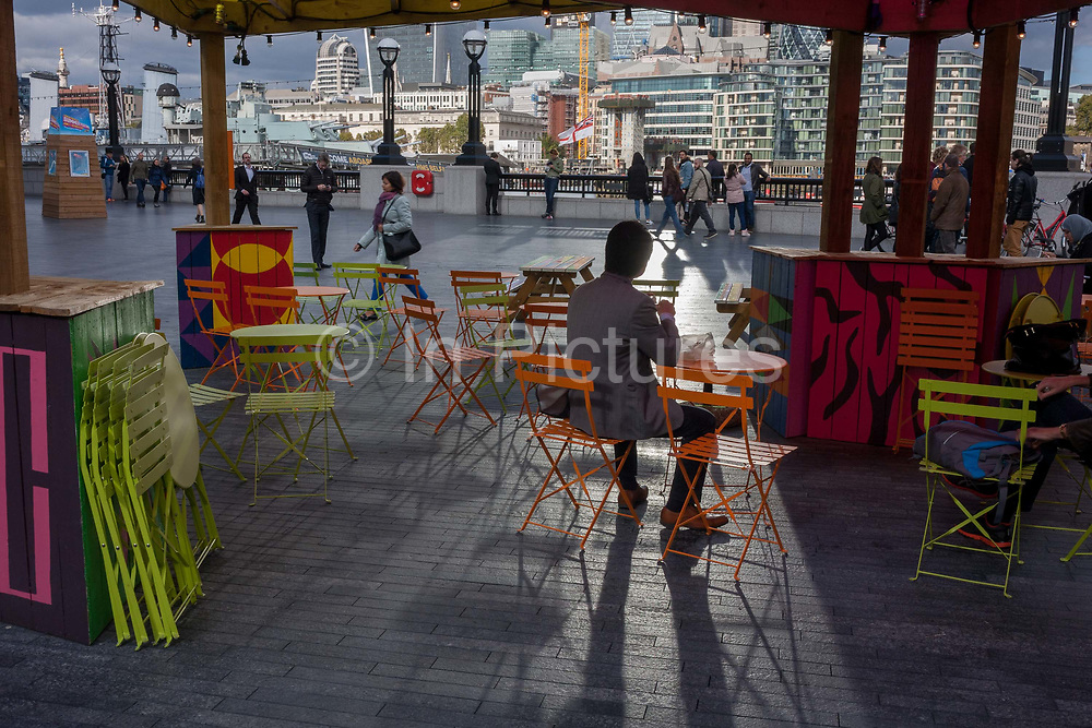A themed cafe promoting the capital as a Riviera, with a background panorama looking north from More London in Southwark, towards the City of London, on 6th October 2016, in London, England.