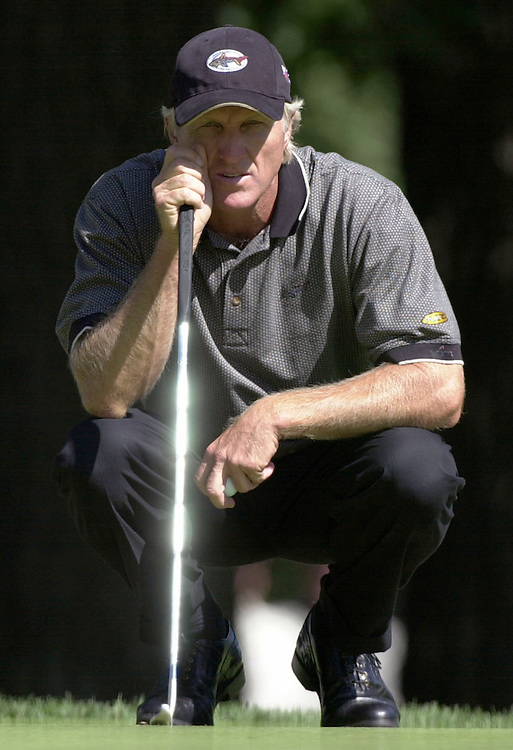 Greg Norman lines up a putt during the practice rounds of the 2003 PGA Championship at Hazeltine National Golf Course in Chaska, Minnesota.