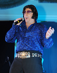"""© Licensed to London News Pictures. 07/01/2012. BIRMINGHAM, UK.  Sergeant Dave Walker of the Parachute Regiments takes part in the annual European Elvis Championship at the Hilton Metropole Hotel at the National Exhibition Centre today.  When Dave is not on duty he spends all of his spare time performing as an Elvis impersonator to raise money for the Parachute Regiment. """"At the end of the day Elvis was airbourne!"""". Stated Dave after the show.  Photo credit: Alison Baskerville/LNP"""