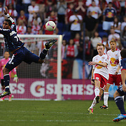Dax McCarty, New York Red Bulls, shoots past Sherjill MacDonald, Chicago Fire, during the New York Red Bulls V Chicago Fire Major League Soccer regular season match at Red Bull Arena, Harrison. New Jersey. USA. 6th October 2012. Photo Tim Clayton