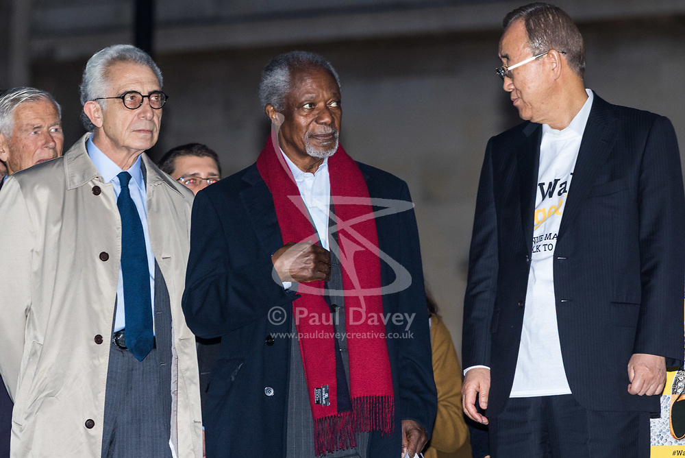 """London, October 23 2017. Nelson Mandela's group of Elders including former UN Secretary General Kofi Annan and Secretary General Ban Ki-moon accompanied by his widow Graca Machel gather at Parliament Square at the start of the Walk Together event in memory of Nelson Mandela before a candlelight vigil at his statue in Parliament Square. """"WalkTogether is a global campaign to inspire hope and compassion, celebrating communities working for the freedoms that unite us"""". PICTURED:  kofi Annan, centre, Ban Ki-Moon (right) and Lakhdar Brahimi. © Paul Davey"""