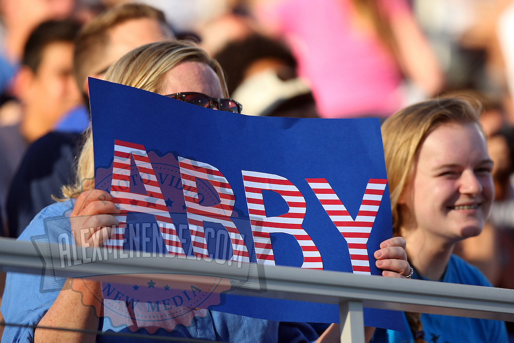 A fan holds up a sign for U.S. forward Abby Wambach (20) during an international friendly soccer match between the United States Women's National soccer team and the Russia National soccer team at FAU Stadium on Saturday, February 8, in Boca Raton, Florida. The U.S. won the match by a score of 7-0. (AP Photo/Alex Menendez)