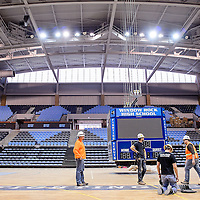 010714       Cable Hoover<br /> <br /> Construction workers and electricians put some of the final touches on the Fighting Scouts Events Center in Ft. Defiance Tuesday. The $37 million, 6,500-seat arena is set to open January 22. The Scouts will face the Paige Sundevils in the venue's first match January 25.