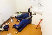 Franciszek Krzeminski and Wladyslaw Gora work on the plumbing of a new wet lab at the Polish Polar Station, Hornsund, Svalbard.