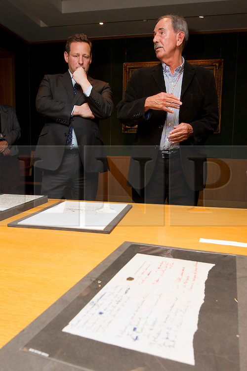 "© Licensed to London News Pictures. 22/05/2013. London, UK. British Minister for Culture, Ed Vaizey (L), and acclaimed Beatles biographer, Hunter Davies, are seen over the original lyrics for the Beatles song 'Strawberry Fields' at the British Library in London today (22/05/2013). The lyrics, along with others and letters between Mr Davies and the late John Lennon, were presented to the library under the ""lifetime giving"" scheme. Photo credit: Matt Cetti-Roberts/LNP"