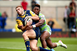 Tom Dodd of Worcester Warriors is tackled by Simon Uzokwe of Newcastle Falcons - Mandatory by-line: Robbie Stephenson/JMP - 29/07/2017 - RUGBY - Franklin's Gardens - Northampton, England - Worcester Warriors v Newcastle Falcons - Singha Premiership Rugby 7s
