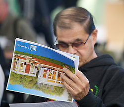 Rudy Munoz reads a brochure as Blu Homes opens their West Coast factory on Mare Island in Vallejo, California Dec. 1, 2011.  Over 400 guests attended a ribbon cutting ceremony at the 250,000-square-foot facility.