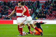 Middlesbrough forward, on loan from Valencia, Alvaro Negredo (10) is tackled by Sheffield Wednesday midfielder Barry Bannan (41) from the floor during the The FA Cup match between Middlesbrough and Sheffield Wednesday at the Riverside Stadium, Middlesbrough, England on 8 January 2017. Photo by Simon Davies.