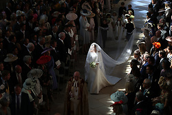 Meghan Markle and her bridal party process up the aisle after arriving at the West Door of St George's Chapel at Windsor Castle for her wedding to Prince Harry.